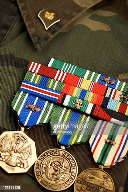 united states medals on camouflage uniform - us military emblems stock pictures, royalty-free photos & images