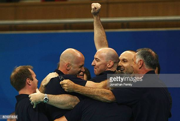 United States Men's indoor volleyball head coach Hugh McCutcheon celebrates victory with his coaching staff after the Gold Medal volleyball match...