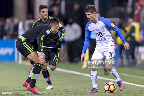 United States Men's National Team player Christian Pulisic dribbles the ball against Mexico Men's National Team player Carlos Salcedo in the first...