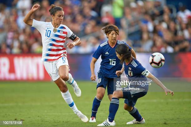 United States midfielder Carli Lloyd battles for the ball with Japan midfielder Rin Sumida and Japan forward Nahomi Kawasumi in game action during a...