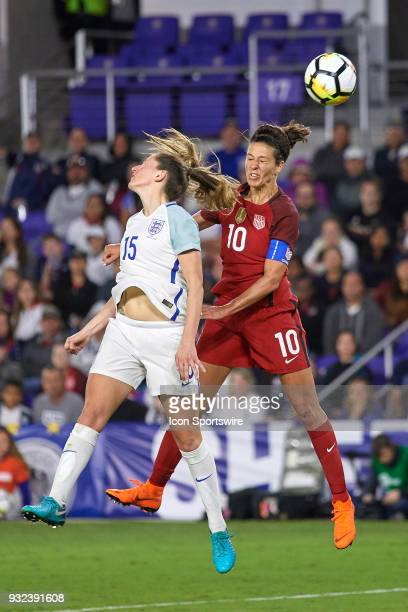 United States midfielder Carli Lloyd battles with England defender Abby McManus to head the ball during the SheBelieves Cup match between USA and...