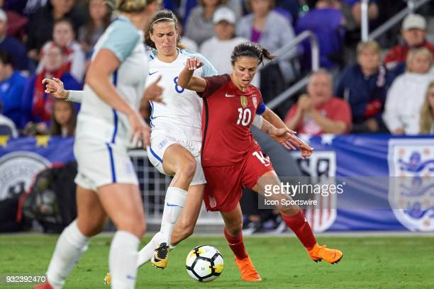 United States midfielder Carli Lloyd battles with England midfielder Jill Scott for a loose ball during the SheBelieves Cup match between USA and...