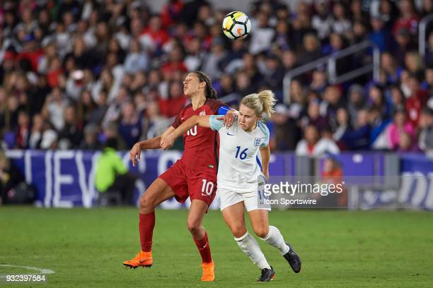 United States midfielder Carli Lloyd battles with England midfielder Isobel Christiansen to head the ball during the SheBelieves Cup match between...