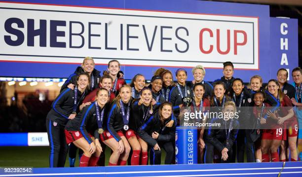 United States midfielder Carli Lloyd celebrates with teammates with the SheBelieves Cup trophy after the SheBelieves Cup match between USA and...