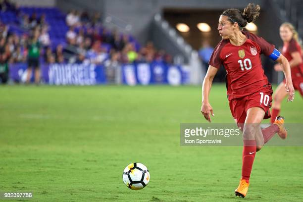 United States midfielder Carli Lloyd dribbles the ball during the SheBelieves Cup match between USA and England on March 07 at Orlando City Stadium...