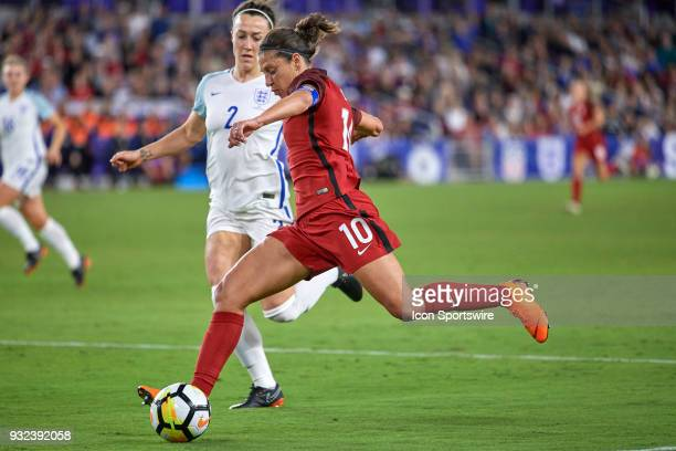 United States midfielder Carli Lloyd shoots the ball during the SheBelieves Cup match between USA and England on March 07 at Orlando City Stadium in...