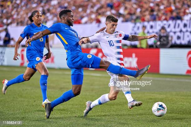United States midfielder Christian Pulisic battles with Curacao defender Darryl Lachman in game action during the CONCACAF Gold Cup Quarterfinal...