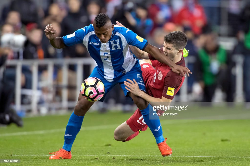 United States midfielder Christian Pulisic #10 collides with Honduras defender Ever Alvarado #5 over a loose ball during their FIFA 2018 World Cup Qualifier between USA and Honduras at Avaya Stadium on March 24, 2017 in San Jose, California.