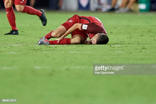 United States midfielder Christian Pulisic holds his ankle after being fouled during the World Cup Qualifying match between the the United States and...