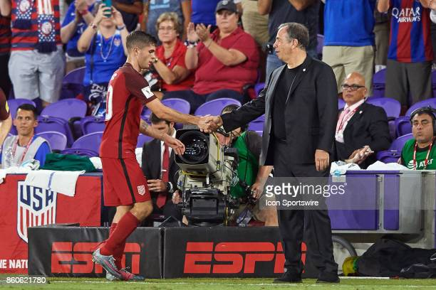 United States midfielder Christian Pulisic shakes hands with United States head coach Bruce Arena after being substituted during the World Cup...