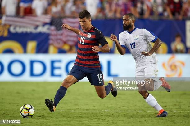 United States midfielder Cristian Roldan battles with Martinique forward Kevin Parsemain for the ball during a CONCACAF Gold Cup Group B match...
