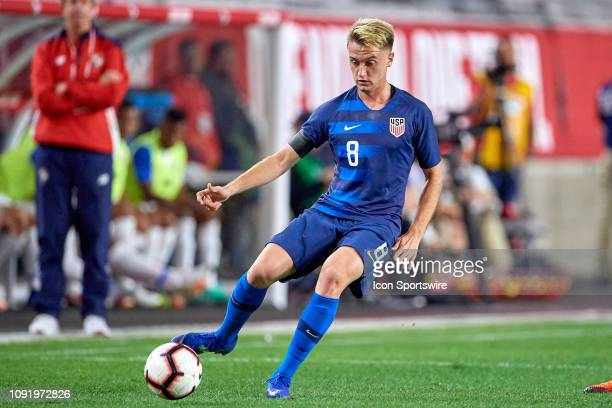 United States midfielder Djordje Mihailovic dribbles the ball in game action during an international friendly match between the United States Men's...