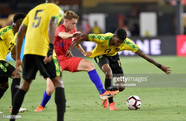 United States midfielder Djordje Mihailovic grabs the jersey of Jamaica defender Damion Lowe during the United States Mens National Team...