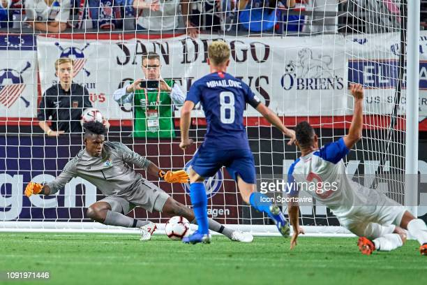 United States midfielder Djordje Mihailovic scores a goal past Panama goalkeeper Eddie Roberts in game action during an international friendly match...