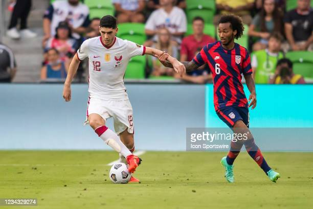 United States midfielder Gianluca Busio attempts to slow down Qatar midfielder Karim Boudiaf during the Gold Cup semifinal match between the United...