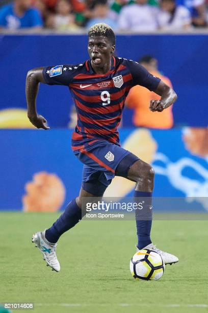 United States midfielder Gyasi Zardes dribbles the ball during a CONCACAF Gold Cup Quarterfinal match between the United States v El Salvador at...