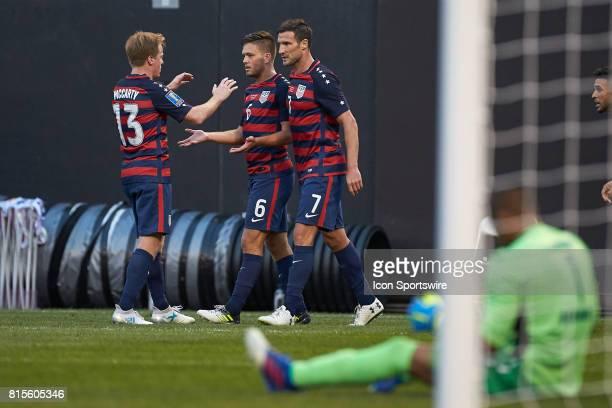 United States midfielder Kelyn Rowe celebrates with United States midfielder Dax McCarty and United States forward Chris Pontius after scoring a goal...
