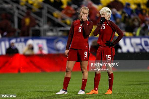 United States midfielder Lindsey Horan and United States forward Megan Rapinoe discuss a penalty kick during the second half of the international...
