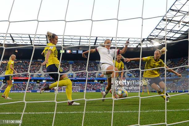 TOPSHOT United States' midfielder Lindsey Horan scores the opening goal during the France 2019 Women's World Cup Group F football match between...