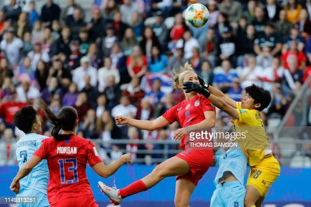 United States' midfielder Lindsey Horan vies for the ball with Thailand's goalkeeper Sukanya Chor Charoenying during the France 2019 Women's World...
