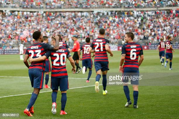 United States midfielder Paul Arriola congratuklates United States midfielder Kellyn Acosta on his goal during an international friendly between the...