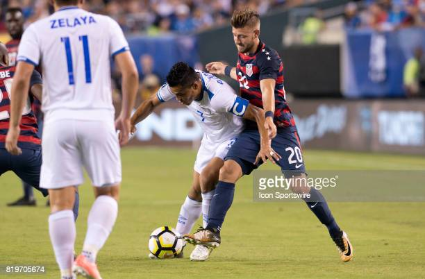 United States Midfielder Paul Arriola tackles the ball away from El Salvador Midfielder Darwin Cerén in the first half during the CONCACAF Gold Cup...