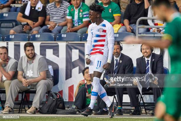United States midfielder Tim Weah celebrates his second half goal with fans and teammates during the international friendly match between the United...