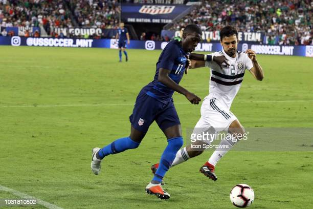 United States midfielder Tim Weah drives past Mexico defender Oswaldo Alanis in the game between the United States National team and the Mexico...