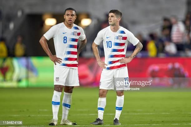 United States midfielder Weston McKennie and United States midfielder Christian Pulisic chat and look on in game action during an International...