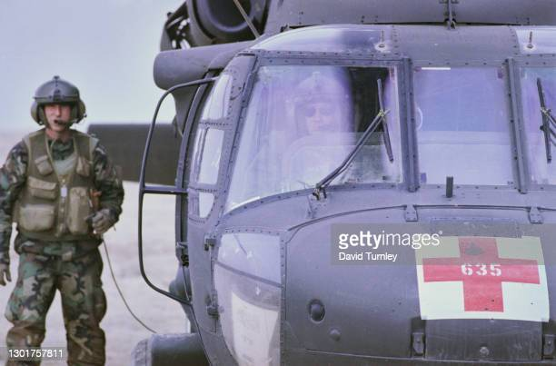 United States military personnel with their Sikorsky UH-60 Black Hawk helicopter at the 5th Mobile Army Surgical Hospital, during the Gulf War, at...