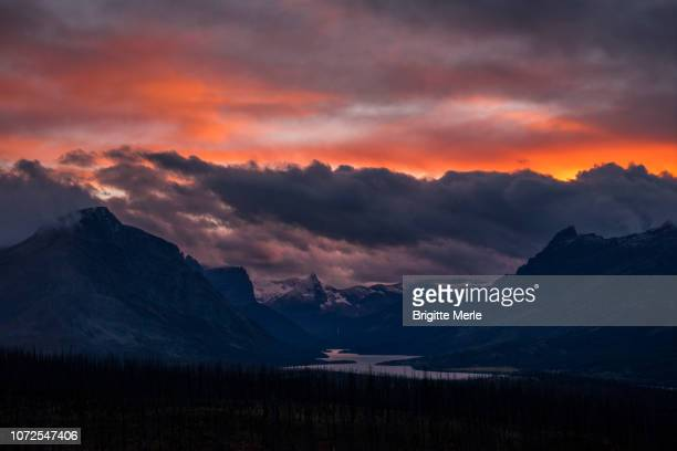 united states, montana, glacier national park, sunset over saint mary lake - mary lake stock photos and pictures