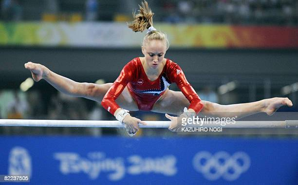United States' Nastia Liukin competes on the uneven bars during the women's qualification of the artistic gymnastics event of the Beijing 2008...