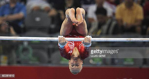 United States' Nastia Liukin competes on the uneven bars in the women's team final of the artistic gymnastics event of the Beijing 2008 Olympic Games...