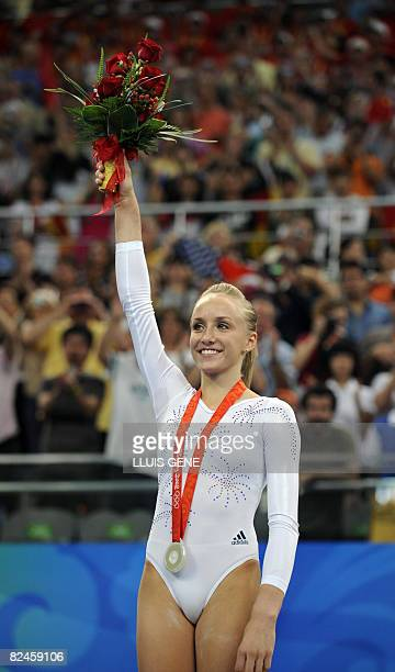 United States' Nastia Liukin stands on the podium after the women's balance beam final of the artistic gymnastics event of the Beijing 2008 Olympic...