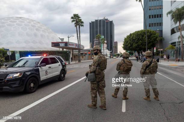 United States National Guard soldiers occupy Sunset Boulevard near the Cinerama Dome theater as large numbers of people are arrested after a curfew...