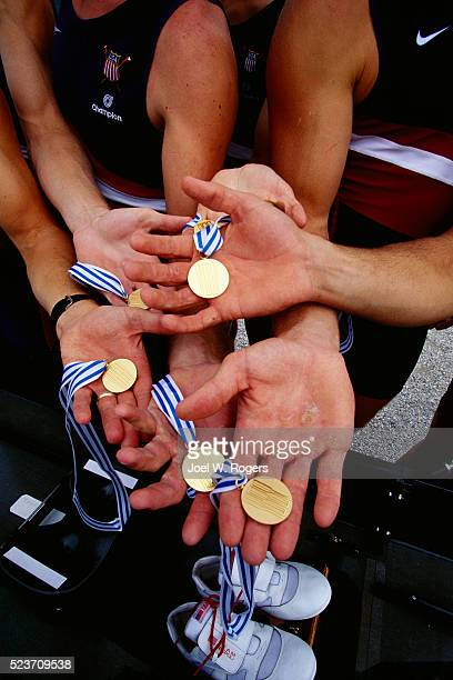 United States National Rowing Team Members Holding Gold Medals