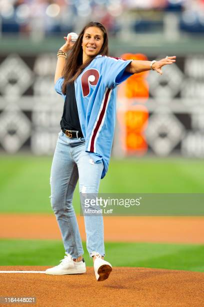 United States national soccer player Carli Lloyd throws out the first pitch prior to the game between the Pittsburgh Pirates and Philadelphia...