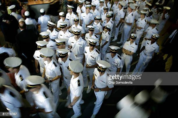 United States Naval Academy midshipmen move toward their seats before the school's graduation and commissioning ceremony at the NavyMarine Corps...