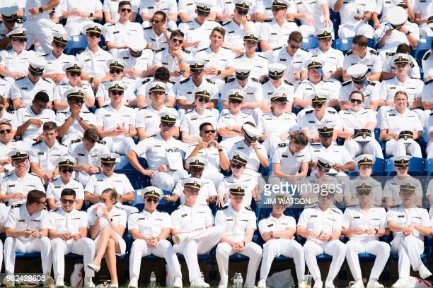 United States Naval Academy midshipmen sit in the stands waiting for the USNA graduation ceremony to begin in Annapolis Maryland on May 25 2018