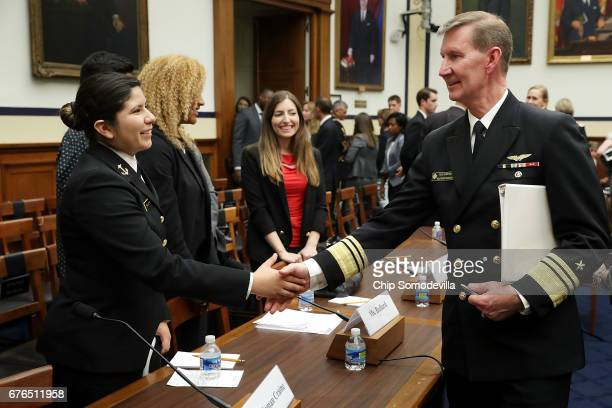 United States Naval Academy Superintendent Vice Admiral Walter Carter shakes hands with Midshipman Second Class Shiela Craine a sexual assault...