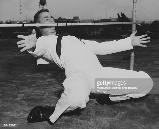 A United States naval officer does the limbo in San Juan Puerto Rico circa 1957