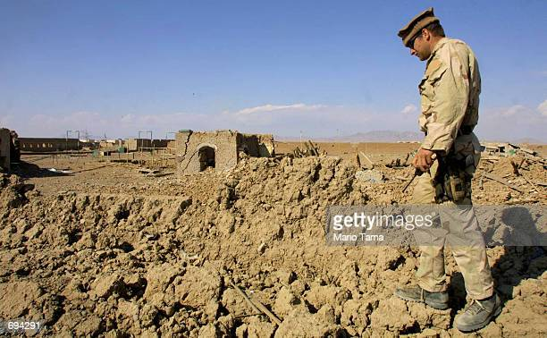 United States Navy AO1 Tim Johns of Hobart Indiana walks on the ruins of the Tornak Farms former terrorist training camp near the American military...