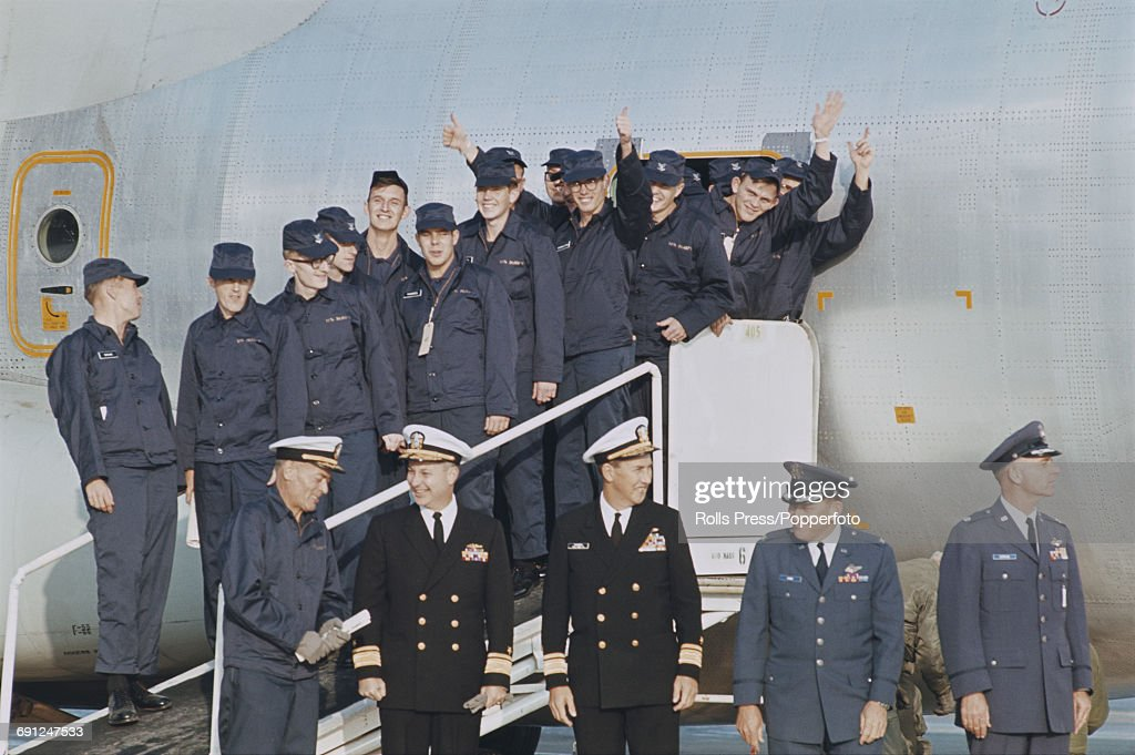United States Navy captain Lloyd M. Bucher (1927-2004) pictured bottom left with members of the crew of USS Pueblo (AGER-2) on their arrival at Kimpo International Airport in Seoul, South Korea on 24th December 1968. The crew of the USS Pueblo have been held captive by North Korean authorities since the ship was attacked and captured by North Korean forces on 23rd January 1968.
