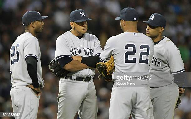CHICAGO United States New York Yankees infielders Eduardo Nunez Alex Rodriguez Vernon Wells and Robinson Cano gather as starting pitcher Andy...