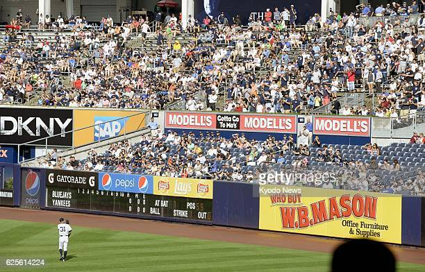 NEW YORK United States New York Yankees outfielder Ichiro Suzuki acknowledges an ovation from spectators while taking the field during the first...