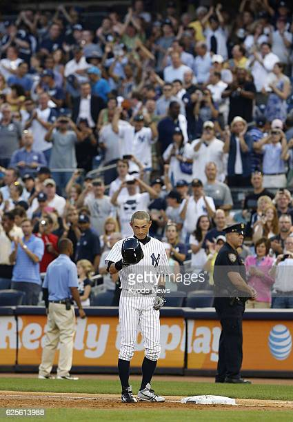 NEW YORK United States New York Yankees outfielder Ichiro Suzuki doffs his helmet to acknowledge cheers from spectators after hitting a single to get...