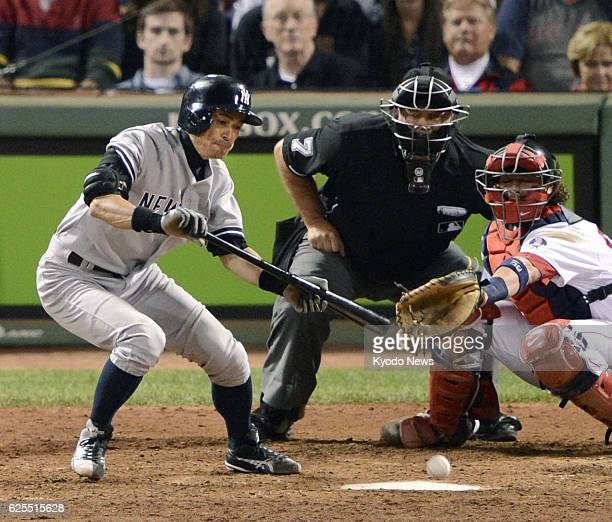 BOSTON United States New York Yankees outfielder Ichiro Suzuki singles on a bunt in the eighth inning of a game against the Boston Red Sox at Fenway...