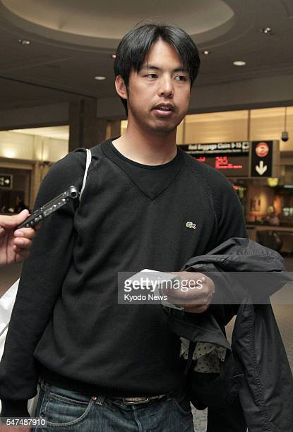 TAMPA United States New York Yankees pitcher Kei Igawa speaks to reporters at Tampa international airport in Florida on March 12 on his way back to...