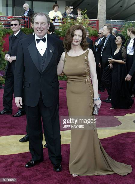 United States: Nominee for Best Original Song Michael McKean and his wife actress Annette O'Toole arrive for the 76th Academy Awards ceremony 29...