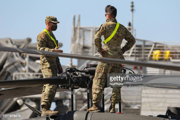 United States of America Army Troops assembly and fix their helicopters after unloading them from ARC ship at the port of Alexandroupoli. Troops of...